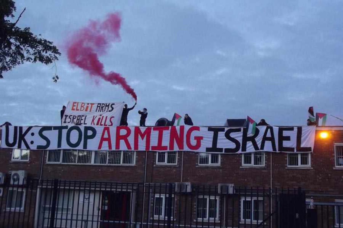 Anti war protesters on roof of factory they claim is 'supplying weapons to Israel'