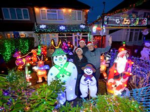 Julia and Nick Barnard, from Westbrook Avenue, Aldridge, with their son Ben and their Christmas lights display which they do every year for charity