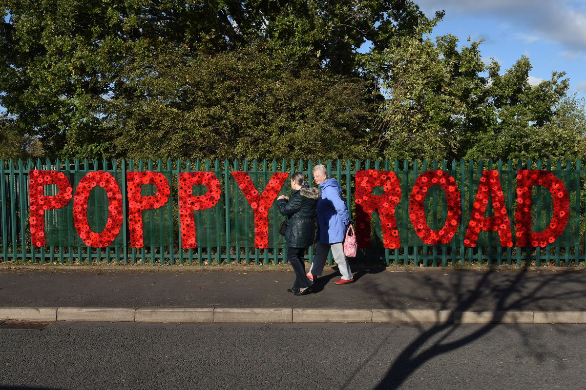People make their way along 'Poppy Road'