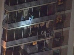 Man climbs down side of 19-storey building to escape fire
