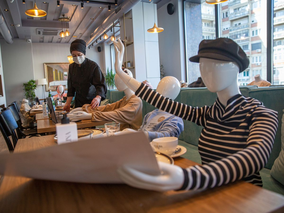 Mannequins are positioned at the tables of Bagolina eatery restaurant, as a protest against the latest government Covid-19 lockdown measures in Kosovo capital Pristina