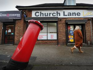 SANDWELL  PIC  / DAVID HAMILTON PIC / EXPRESS AND STAR PIC 8/01/21 A Royal Mail post box, tilting dangerously after being hit by a car, at Church Lane, West Bromwich..