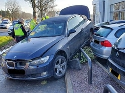 BMW driver loses control and crashes into Oldbury BMW garage