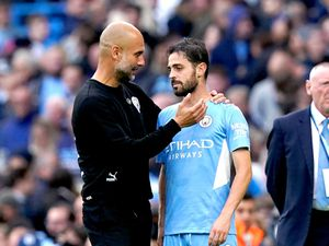 Manchester City manager Pep Guardiola speaks to Bernardo Silva at the end of the match