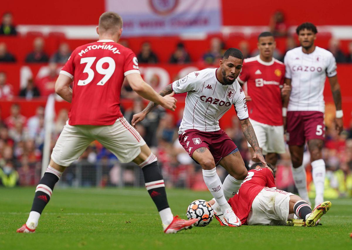 Aston Villa's Douglas Luiz (centre) takes on Manchester United's Scott McTominay