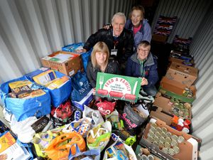 CANNOCK COPYRIGHT EXPRESS&STAR TIM THURSFIELD 05/11/19.Heather Large with David Clarke, chairman of Lichfield Food Bank, who have donated a large amount of food for the Express & Star's Feed A Family initiative. Also pictured are Christina and Richard Mallender from the food bank...