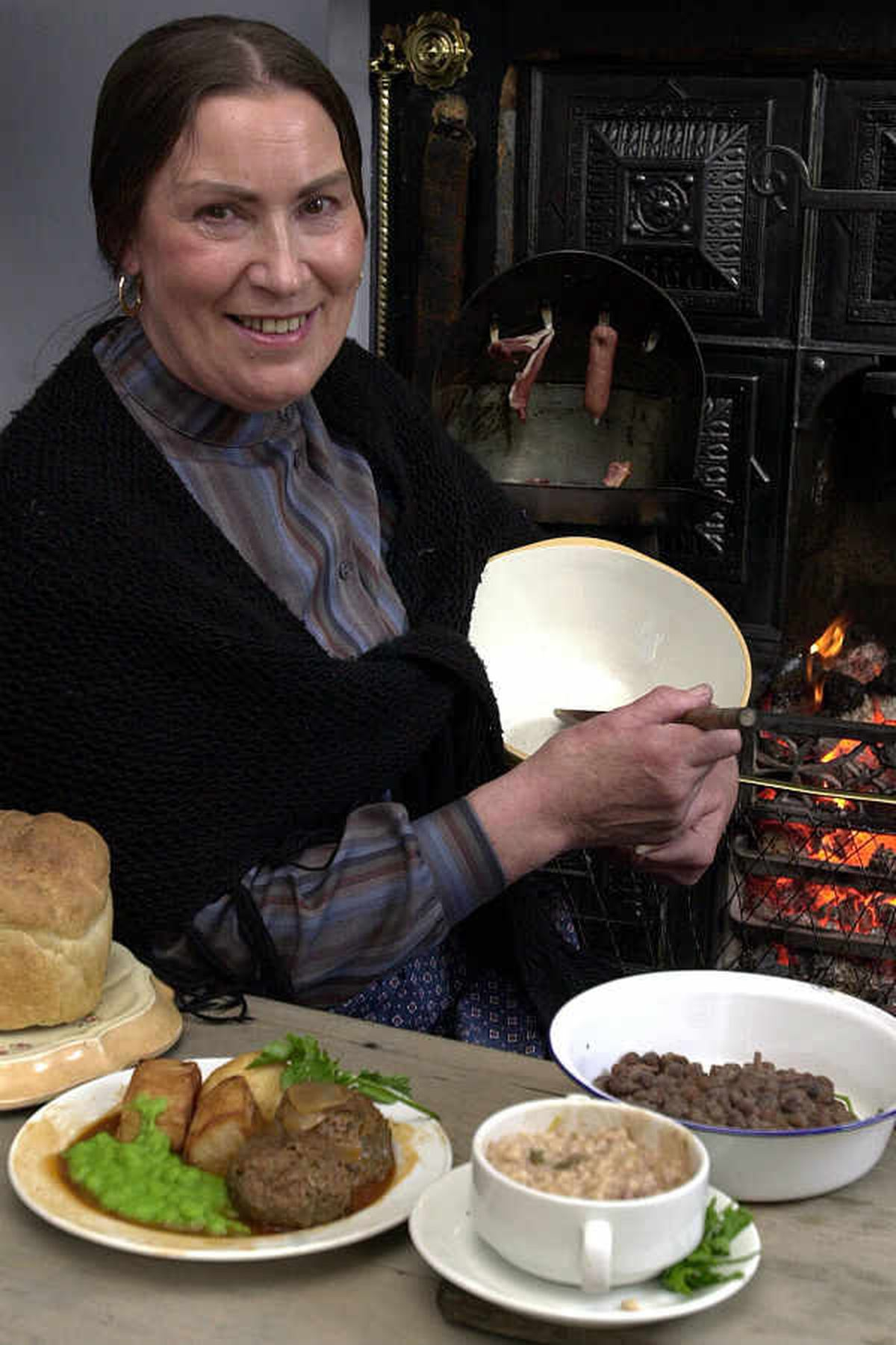 Bessie Hawkes a demonstrator at The Black Country Living Museum with faggots and peas with groates pudding