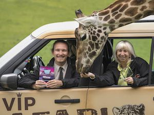 Tom Bache and Sue Day from West Midland Safari Park celebrate being head and shoulders above the rest for group travel.
