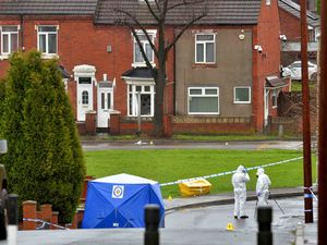 Police in Brierley Hill after the alleged murders