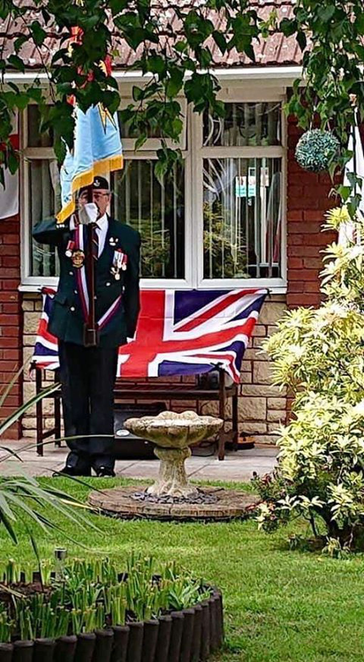 Standard bearer for Wolverhampton Combined Ex-Services Council Graham Tilley paid his respects with neighbours in Kingsclere Walk, Merry Hill