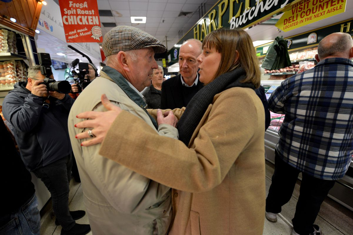 Labour leadership candidate Jess Phillips chats with shopper Alan Doughty.
