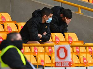 Conor Coady and Joao Moutinho look dejected after both being taken off (AMA)