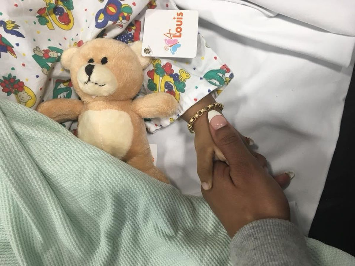 Sabrina holds Dataeo's hand