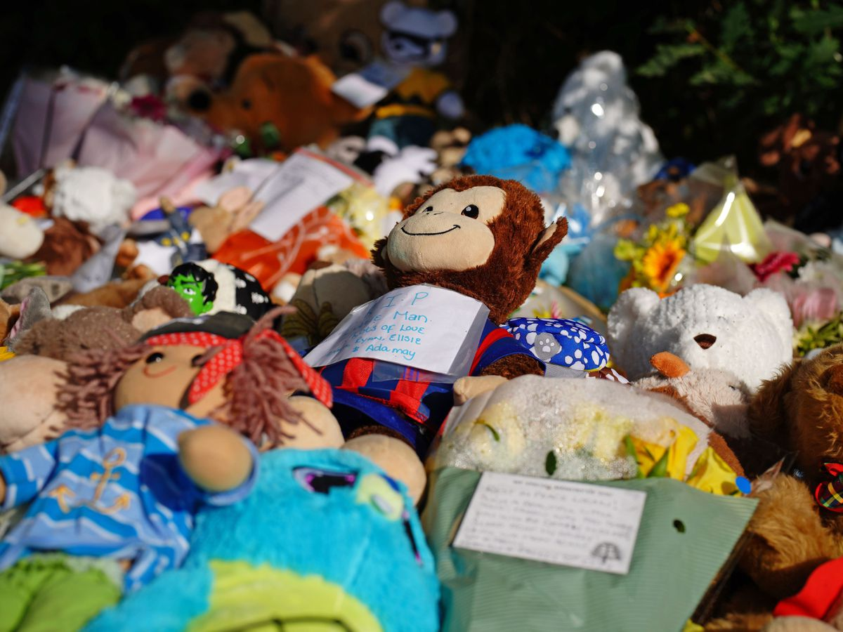 Tributes left at the scene in the Sarn area of Bridgend, south Wales, near to where five-year-old Logan Mwangi was found dead in the Ogmore River