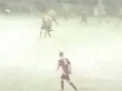 This game in Wales amazingly wasn't called off despite no one being able to see through the snow