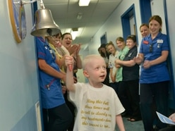 WATCH: Emotional day for brave boy Oscar as he rings End of Treatment Bell