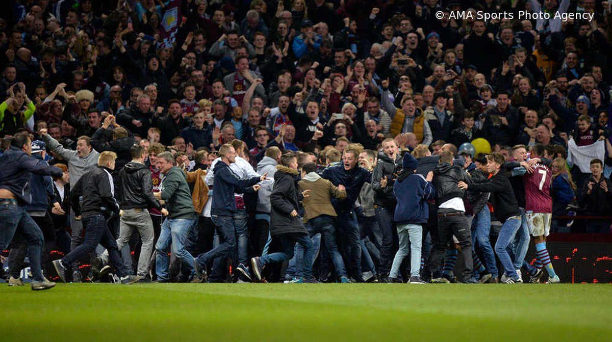 Aston Villa fans invade the pitch during the match after Scott Sinclair scored Villa's second goal