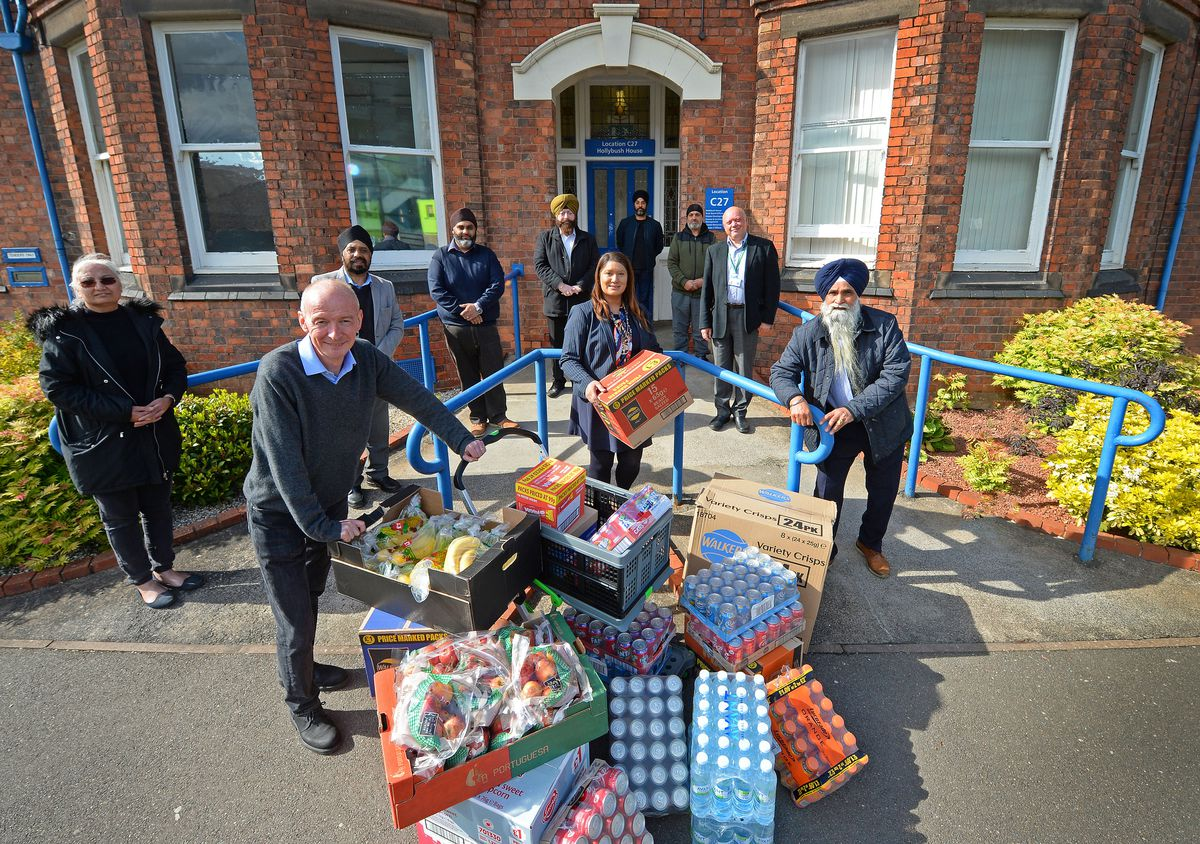 Representatives of the Guru Ka Niwas Gurdwara pictured with some of the food they donated to New Cross Hospital with Pat McFadden MP and Councillor Jas Dehar