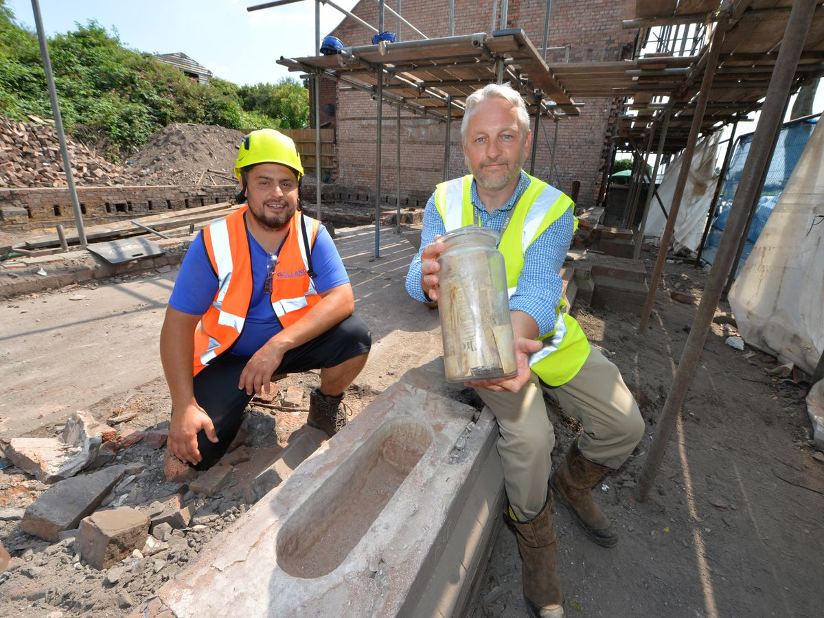 Stephen Holland and John Hughes with the time capsule