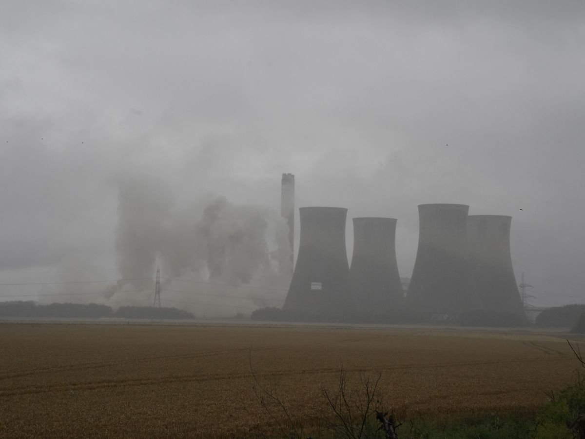 Four of the eight cooling towers at Eggborough power station are demolished by explosives