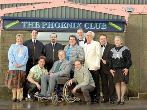 Archie Kelly (centre, kneeling next to Peter Kay) and Janice Connolly, aka Barbara Nice (far left)