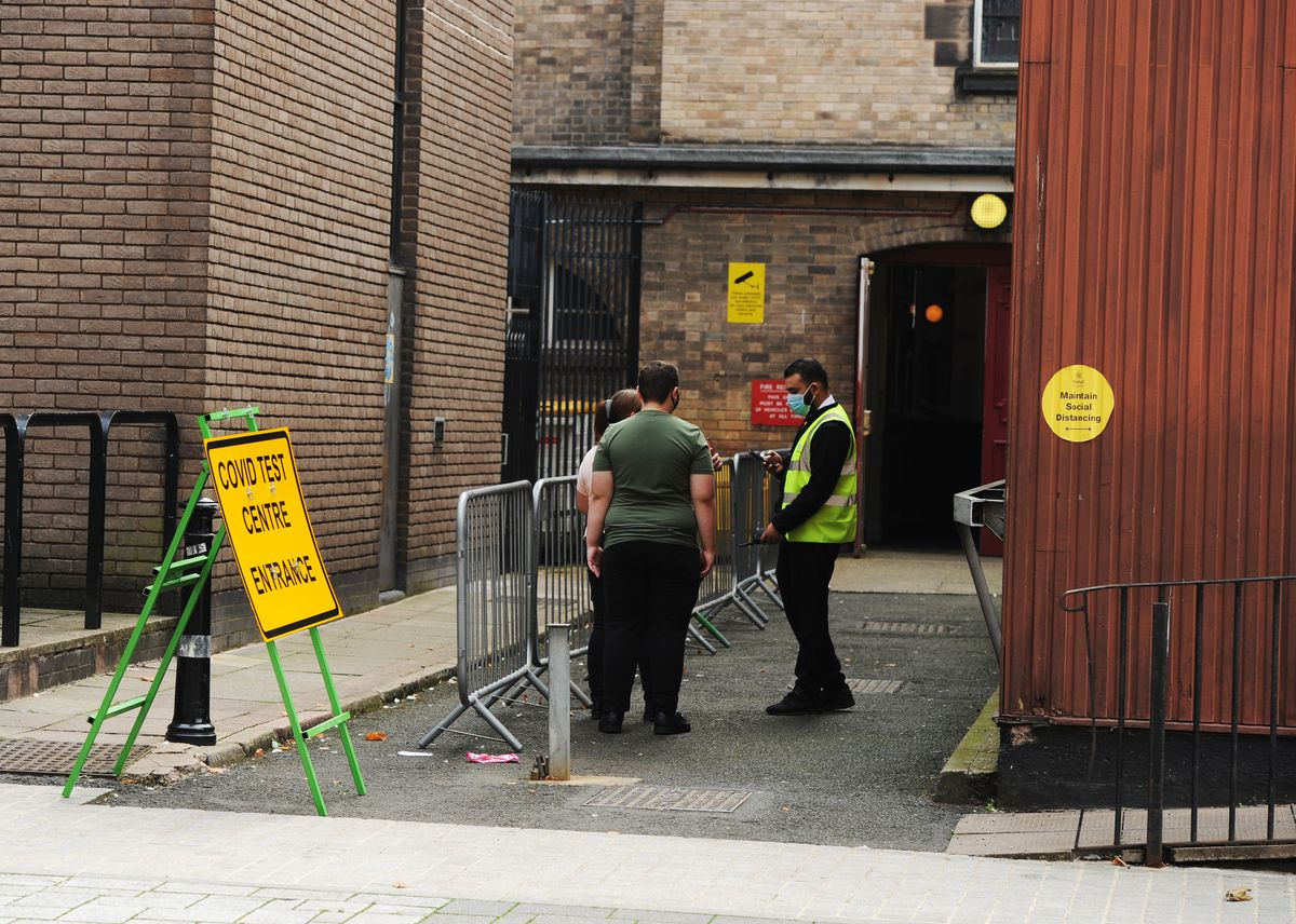 People attempting to get in for a Covid test at the Walsall Town Hall site