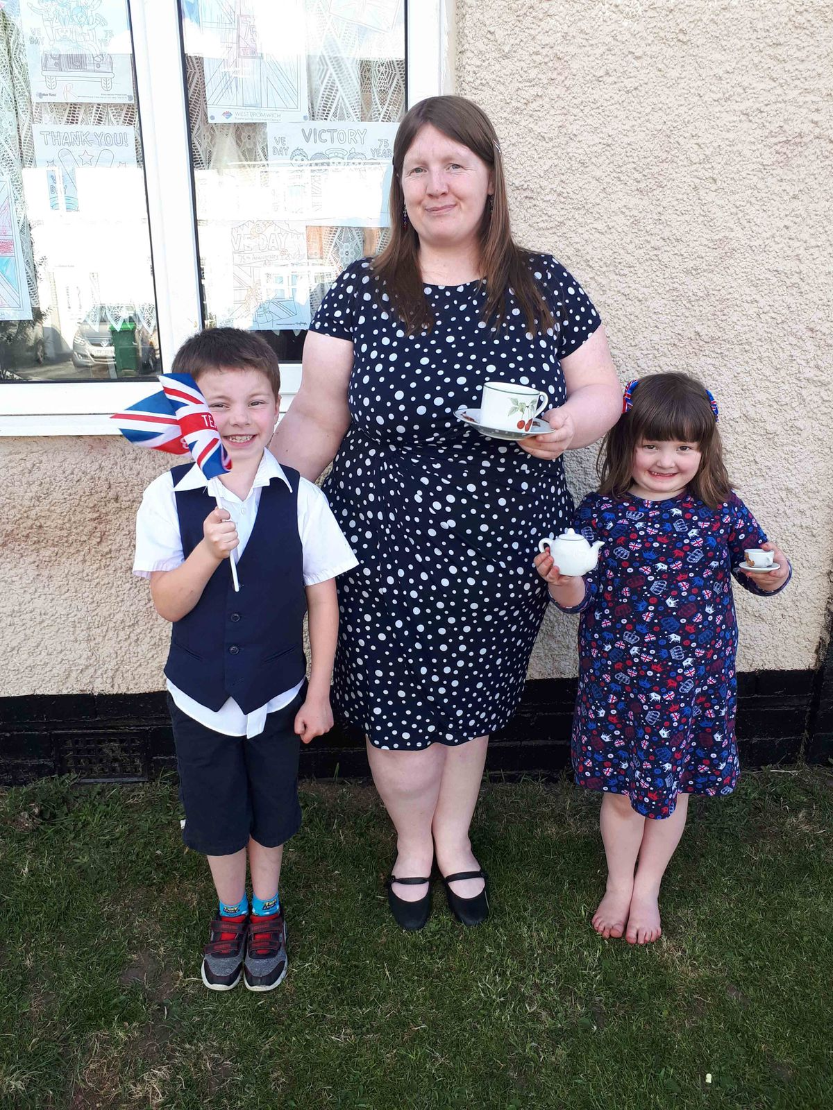 Jack, Alice and Stacey Hutchins celebrating with tea and sandwiches in Oldbury