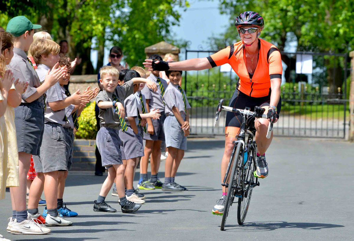 Alexandra Heath is cheered on by pupils after her epic journey from Buckingham Palace to Birchfield School, Albrighton