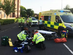Paramedics tended to a man after the road traffic collision. Photo: Trevor Beech