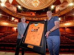 Wolves fan celebrates after winning signed shirt in auction to help Grand Theatre