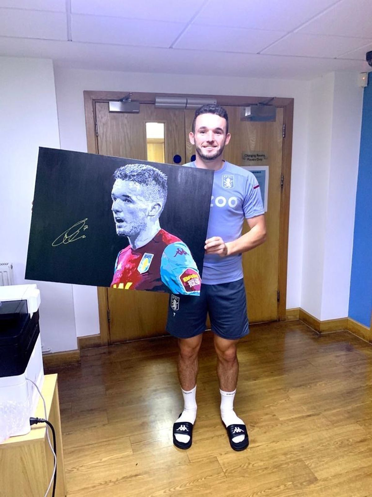 John McGinn with his signed painting.