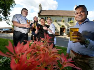Business is good at the Greyhound in Penn. Pictured front is boss Rume Manoharan, and from the left are staff Peter McDougall, Damon Peschel, Francesca Painter and Katie Scollen