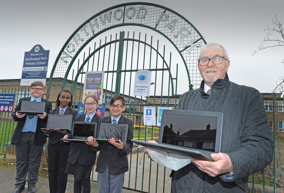 Councillor Alan Butt, from Wolverhampton, is donating a number of laptops and internet dongles to a school for the school's catch up regime now the kids are back. Councillor Butt is pictured at Northwood Park Primary School, Collingswood Road with year 6 students head boy Mason Plumb, aged 11, Jemiemah Darko-Boateng, aged 10, head girl Amelia Powell, aged 11, Damien King, aged 11