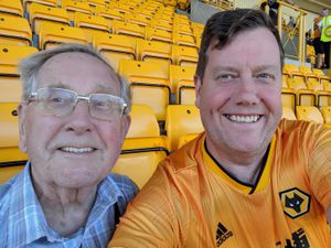 Father and son Wolves fans Mike, left, and Ian Davies. Mike, who has dementia, attended his final Wolves game in the 2-1 defeat to Manchester United last Sunday. He has watched Wolves for nearly 80 years.
