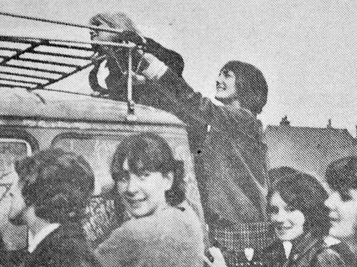 Girls clamber on the group's van in Cannock during their 1964 gigs in the town.