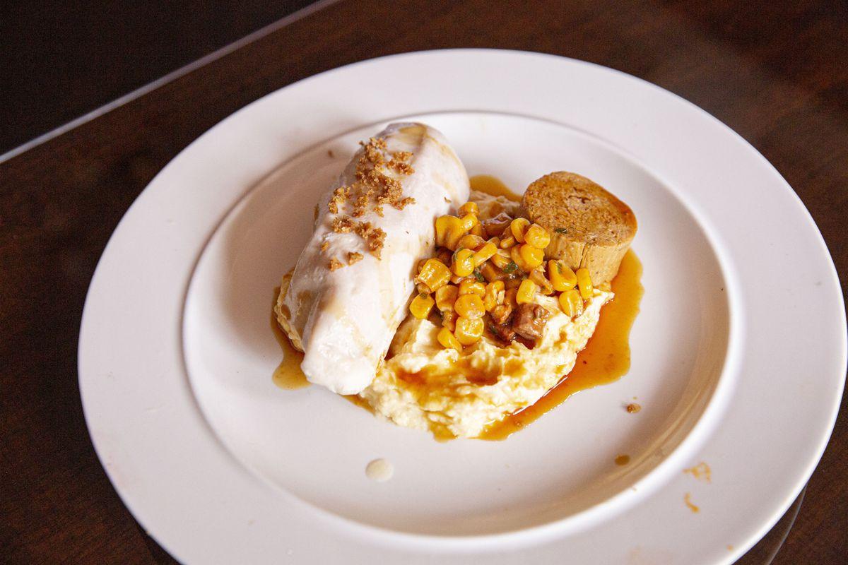Butter poached chicken, confit leg, cow corner milk polenta and sweetcorn relish