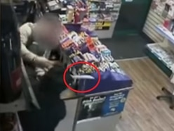 WATCH: Hero shopkeeper tackles knife-wielding masked robber during terrifying raid