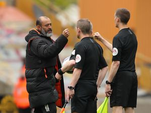 Nuno Espirito Santo the head coach / manager of Wolverhampton Wanderers fist bumps the officials at full time (AMA)