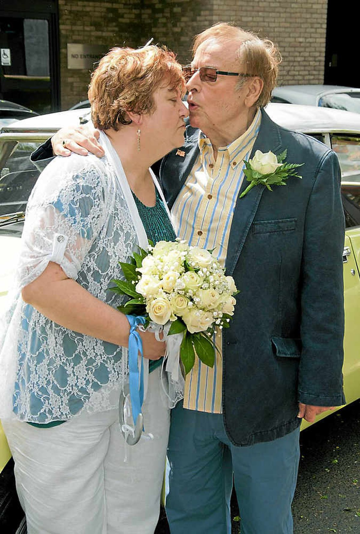 Sealed with a kiss – the happy couple