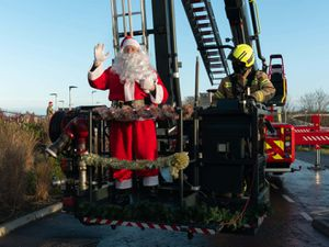 Santa with a firefighter