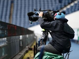 A TV / Television cameraman with camera at the side of the pitch. (AMA)