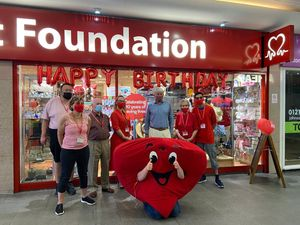 Andrew Mitchell with volunteers at the British Heart Foundation