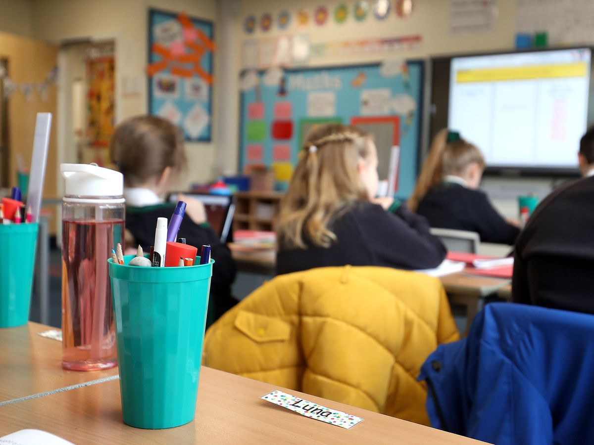 School pupils take part in a maths lesson