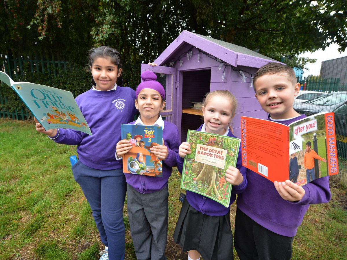 Picking books at the little free library, which has opened outside Christ Church Primary School, Oldbury, pupils (left-right) Pia Ranahawa, aged nine, Pahul Ranahawa, aged five, Isla Rudd, aged five and Oliver Rudd, aged eight.