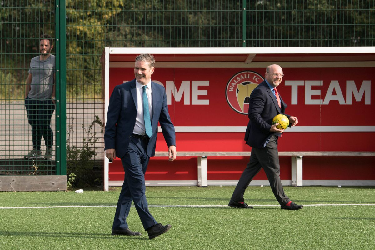 Labour leader Sir Keir Starmer (left) with MP Liam Byrne during a visit to Walsall FC. Photo: Stefan Rousseau/PA Wire.
