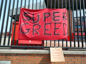 A banner outside Anfield in Liverpool protesting about the club's decision to join a Super League