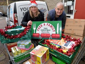 Reporter Heather Large with Gary Price from The Well during the final day of Feed a Family This Christmas deliveries