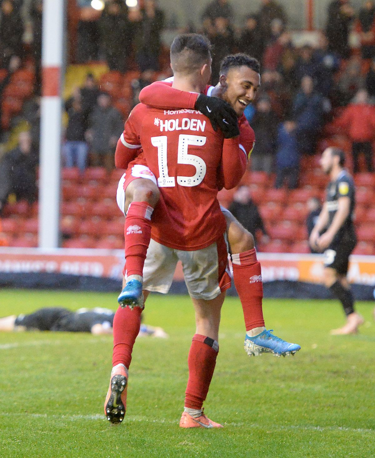 Rory Holden celebrates his winner against Northampton with Wes McDonald
