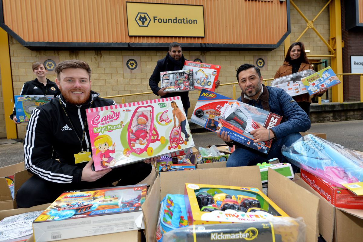 Wolves Foundation show off some of the toys donated by Sikh Toy Appeal and Punjabi Wolves. From left, Rachel Smith, Steve Cullis, Manny Johal, Andy Sahota and Meetu Singh.