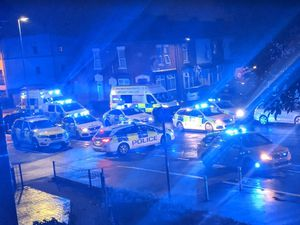 Police at the scene in Smethwick after a woman was stabbed